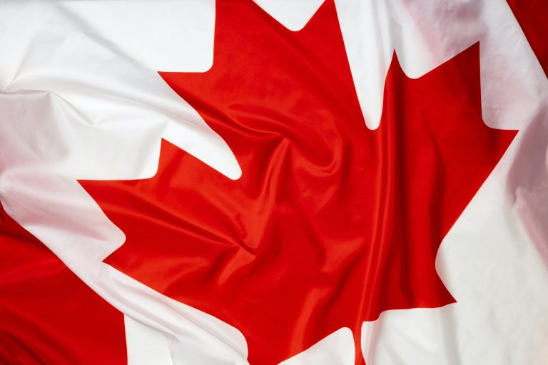 Rippled textile flag of Canada close up